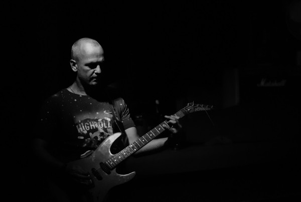 Dominic playing guitar - Solscape